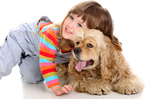 A child with her pet dog playing on a floor cleaned by Hains Dry Carpet Cleaning